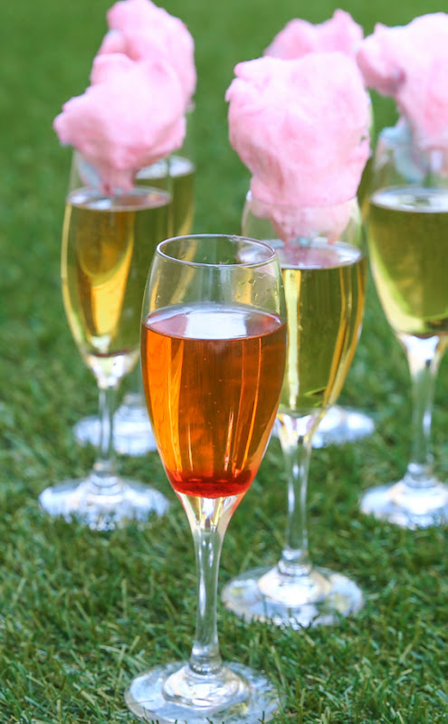 a glass of champagne after the cotton candy has been added and has dissolved