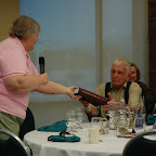 Alice Hix presents Gleaves History to Mr. James Dunkley, Sr.