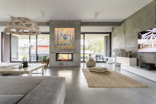 Mixed media painting in minimalist living room