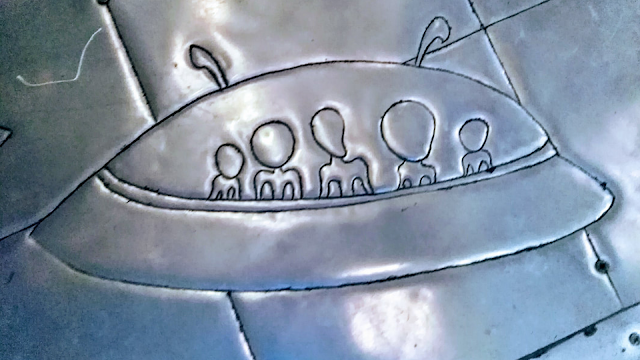 Flying Saucer carved into the Silver Temple in Thailand.