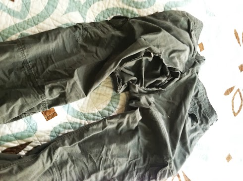 Rip stop pants, ripped to shreds by metal roof