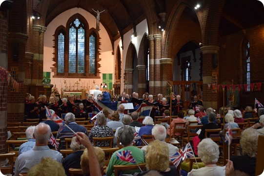 The audience wave their flags during the Wistaston Singers  concert