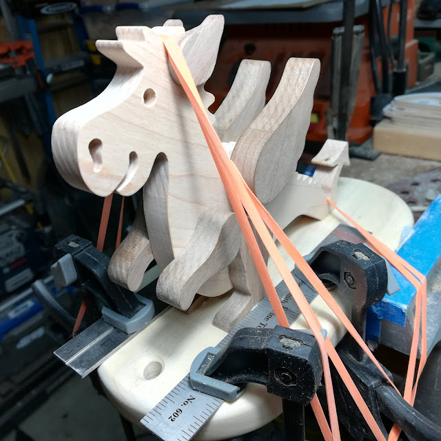 Handmade Wood-Dragon Glued and Clamped to the Base Using Rubber Bands