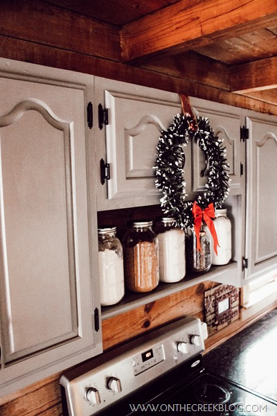 Christmas wreath in between cabinets