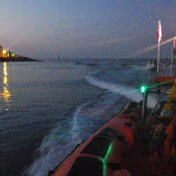 Helmsman Ed Davies tows a broken down fishing boat into Poole Harbour past the Haven Hotel in the early hours - 9 July 2013 Photo: RNLI/Poole Lifeboat Station