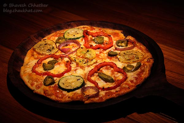 Thin-crust Gourmet A La Toss Pizza served at Toss Sports Lounge Koregaon Park