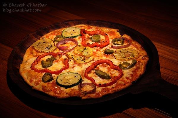 Thin-crust Gourmet A La Toss Pizza served at Toss Sports Lounge Koregaon Park