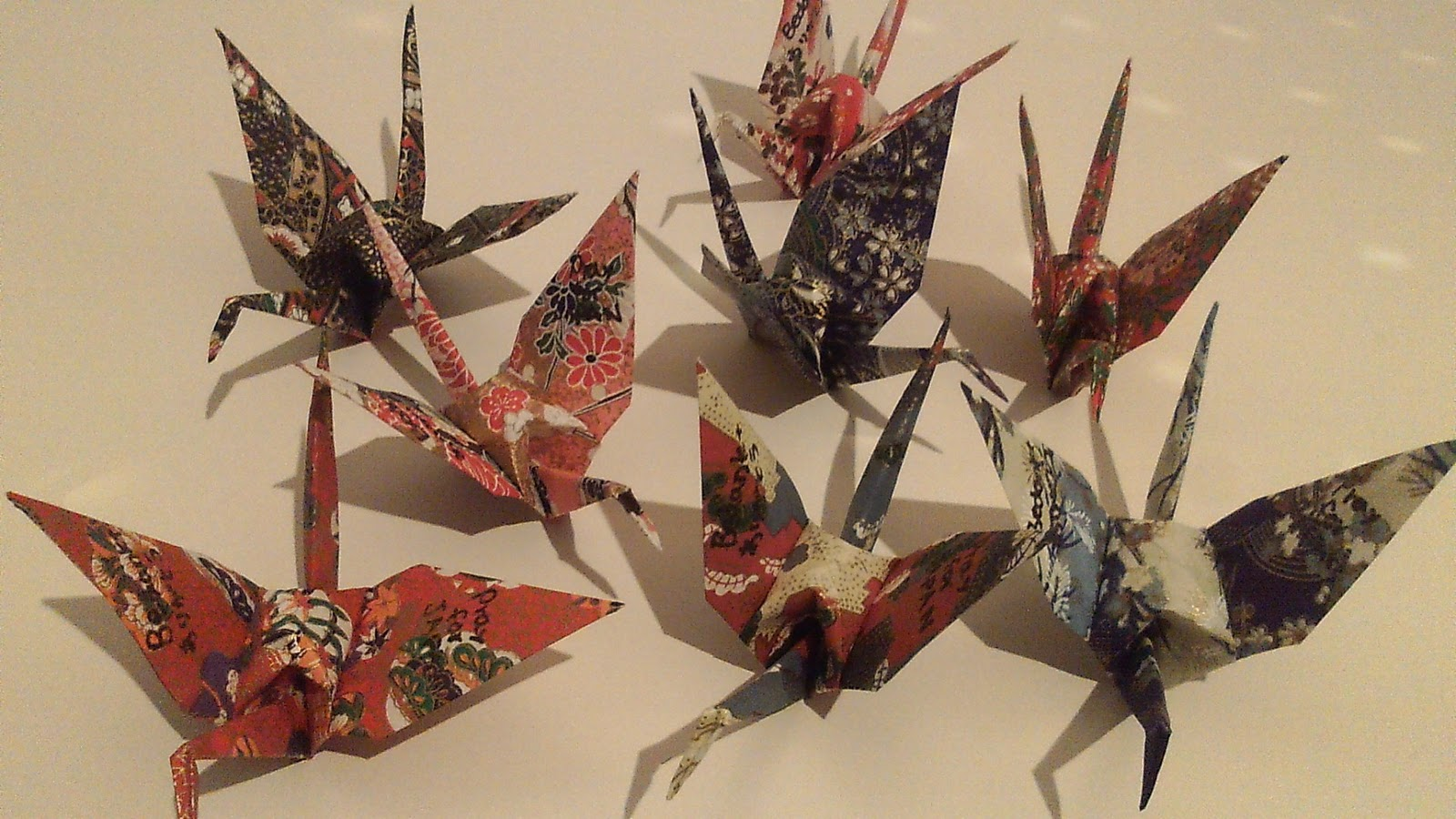 Orizuruprayforjapan please collect donations making origami birds 1what is origami birds orizuru origami is a unique japanese art in which various forms such as animals and flowers are created jeuxipadfo Image collections