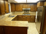 Kitchen with granite countertop, stainless steel cooktop, hood, double door fridge, double sink and dishwasher. Tons of storage including practical pull-out closets.