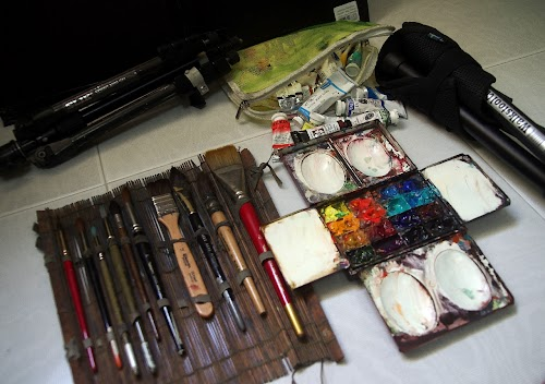 Assortment of brushes in bamboo mat, hand-made Craig Young paint box, paint tubes in zip bag, SLIK Sprint Mini tripod converted into portable easel, Walkstool, corrugated board
