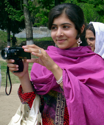 """Malala Yousafzai with camera"""