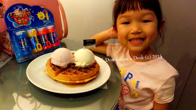 Tiger girl with her ice-cream waffle