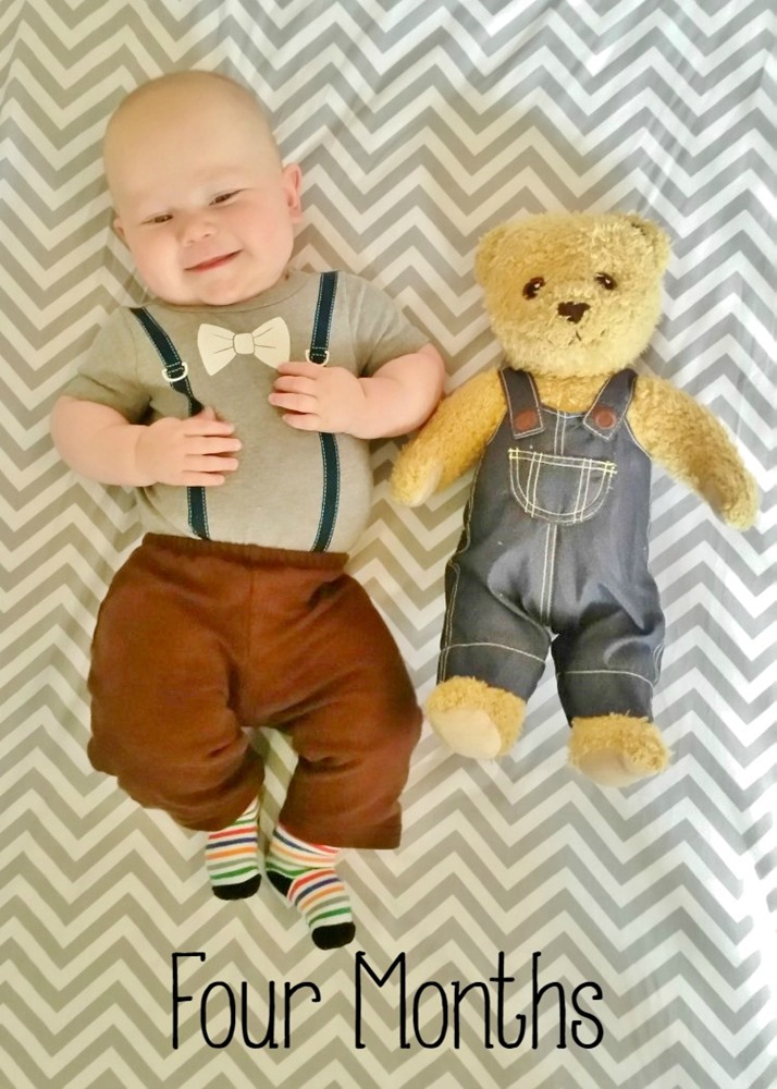 Baby boy with stuffed bear image.