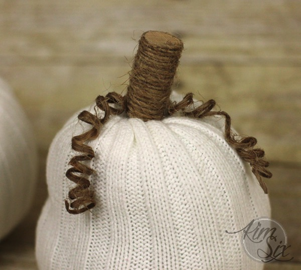 Wooden and twine stem on cloth pumpkin