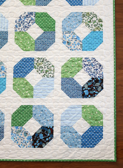 Layer Cake Lucy quilt pattern by Andy of A Bright Corner in Morrison Park fabrics by Pat Sloan