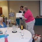 Alice Hix donates the family history to Cathy Reynolds, Archivist for the Wytheville Community College Library.