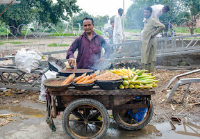 Corn seller on the road, Lahore
