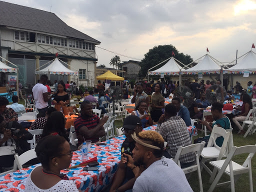 people eating at eat drink lagos festival of jollof