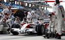 Jarno Trulli (ITA) Toyota TF108 makes a pit stop