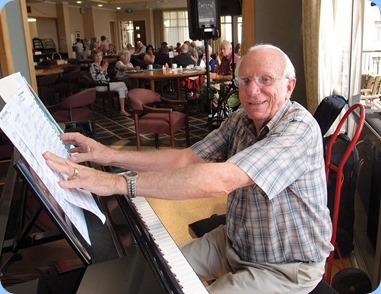 Rob Powell playing the K. Kawai grand piano. Photo Courtesy of Dennis Lyons.