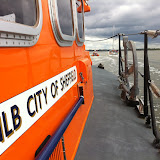19 July 2012 - Poole all-weather lifeboat and inshore lifeboat escort a vessel that had originally gone aground. Photo: RNLI/Poole Dave Riley
