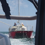 3 August 2011 - Poole inshore lifeboat towing a 6.5m catamaran back into Poole Harbour (Photo: RNLI/Poole Lifeboat Station)