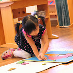 Here, a Montessori preschool girl in Irvine is working with a puzzle map of South America.