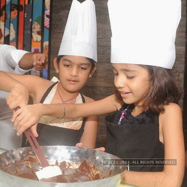 Jiya (Ritu's daughter) with a friend during the chocolate making session hosted Ritu Beri at the Delhi Baking Company, JW MArriott, Aerocity.
