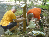 Installing Trail Markers 2 Verse plaque affixed to wooden post