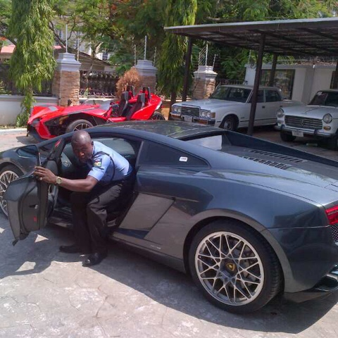 senator dino melaye's ferrari that zakkay Azzay posed with