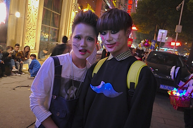 two people wearing Halloween costumes in Changsha, China