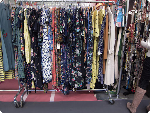 Racks of vintage clothing.