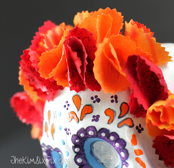 Fabric flowers on sugar skull