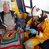 Crew Member Alex Evans using the casualty check cards during a training exercise - 22 April 2014 Photo: RNLI Poole/Anne Millman