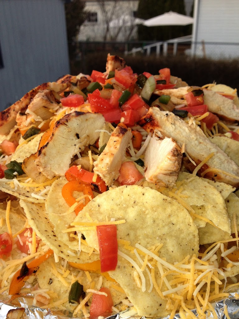A generous helping of leftover chicken, tomatoes, and cheese make the perfect grilled nachos.