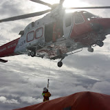9 October 2011. Crew Member Dave Leabourne being winched aboard HM Coastguard helicopter 106. Photo: Poole RNLI/Ade