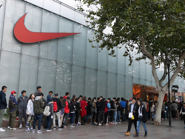 line of people outside a Nike store in Shanghai