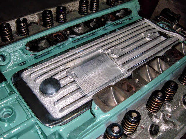 Special Valley Cover for the factory 2-4 intake, there are CNC'ed for proper clearance.. 375.00