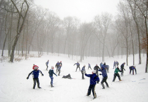 MPLS SW skiers playing a game in the heavy snow in the back bowl/sledding area.