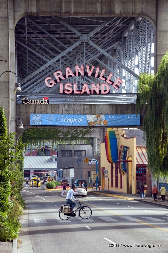 The sign marking the entrance to Granville Island under the bridge that goes over the island