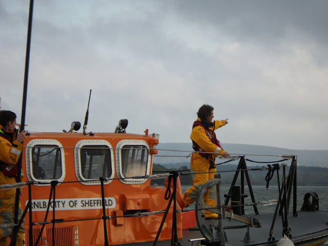 Crew Member Suzie Jupp pointing to a person overboard during a training exercise - 22 April 2014 Photo: RNLI Poole/Anne Millman