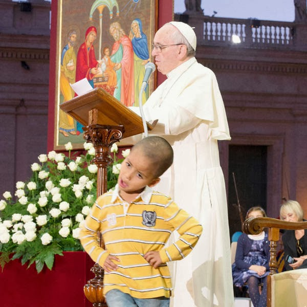 Francis was speaking in St. Peter's Square about the important role grandparents play when a little boy walked up behind him and confidently climbed up and sat down on the pontiff's white chair.