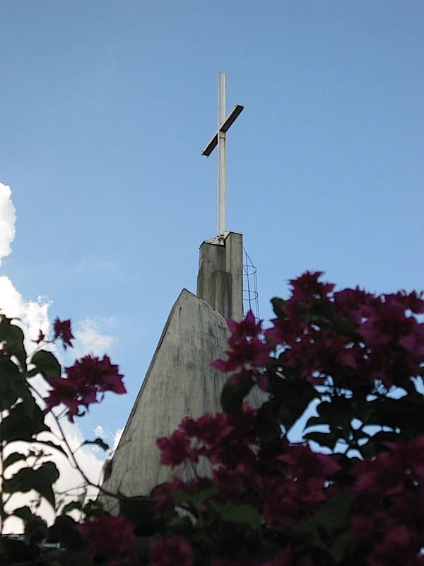the simple cross at the top of the Immaculate Heart of Mary Parish church