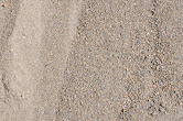 Mason Sand - Finer grain sand but is not as clean. Used for placing underneath and around pavers, wall blocks, and under swimming pools.