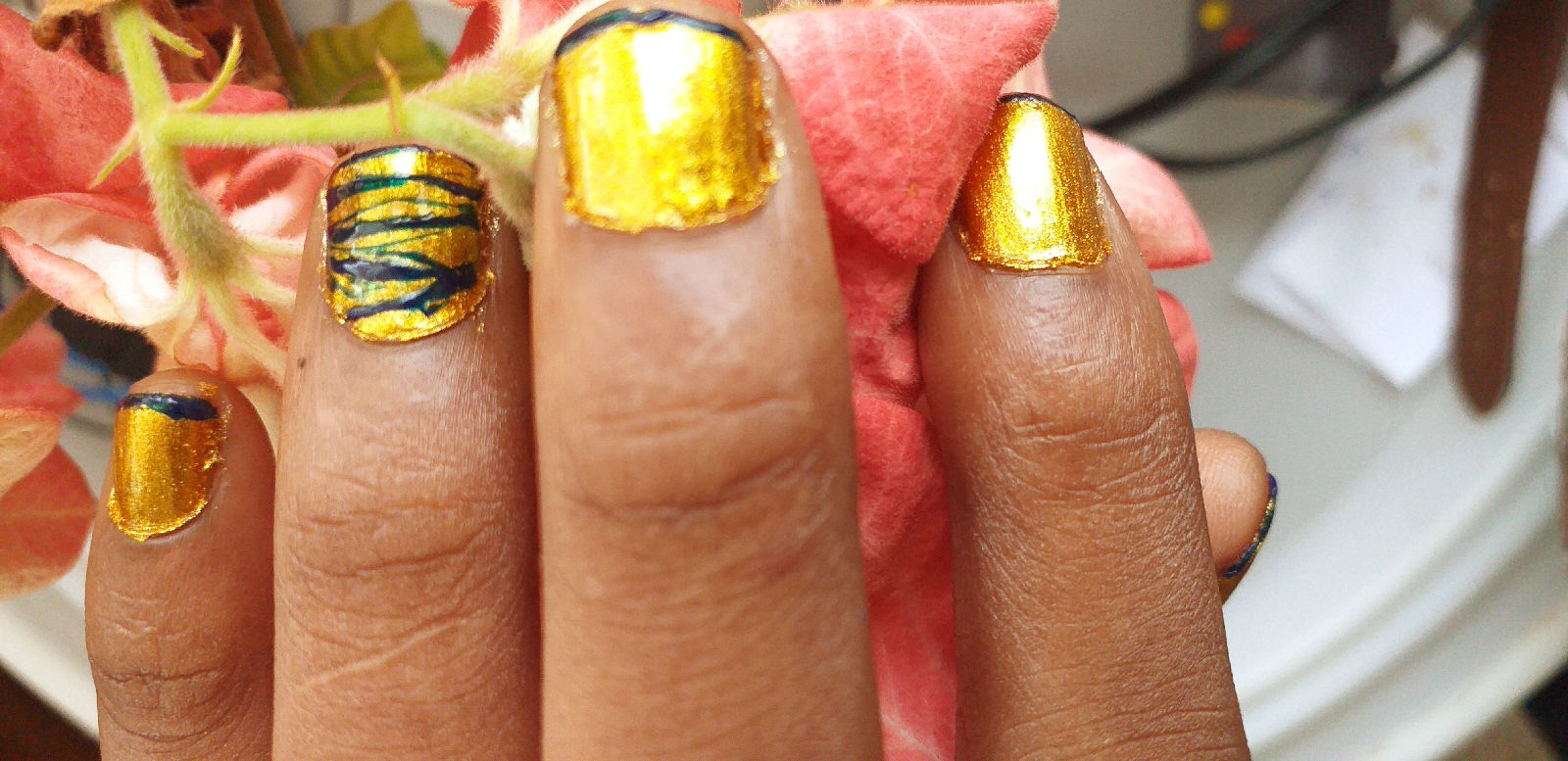Gold and midnight nail color