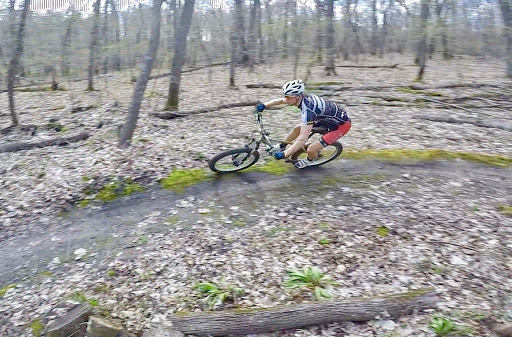 """Riding ther berm on """"Hudson's Hula"""" segment of Twin Lakes singletrack"""