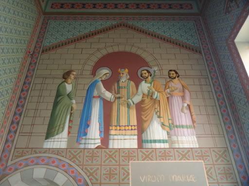 A arte sacra representa São José e a Virgem Maria contemplando a união da qual veio nosso Salvador