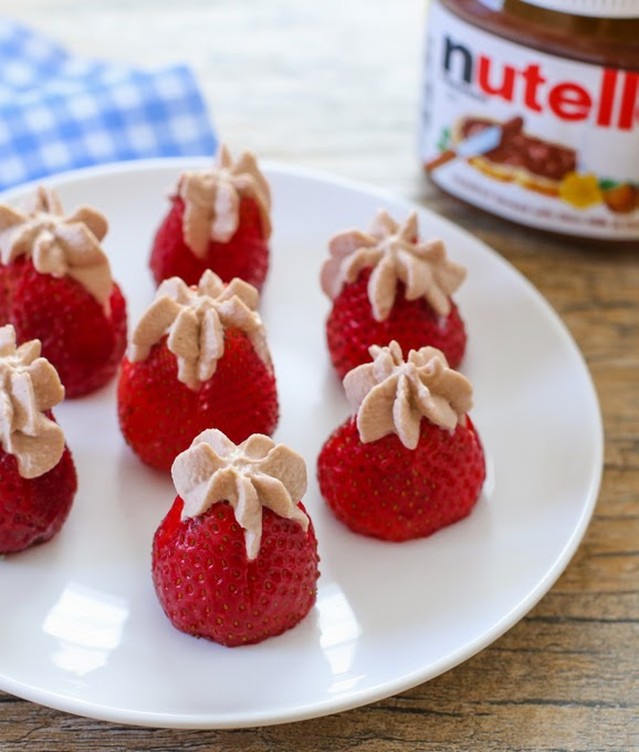 photo of a plate of Nutella Cream Stuffed Strawberries