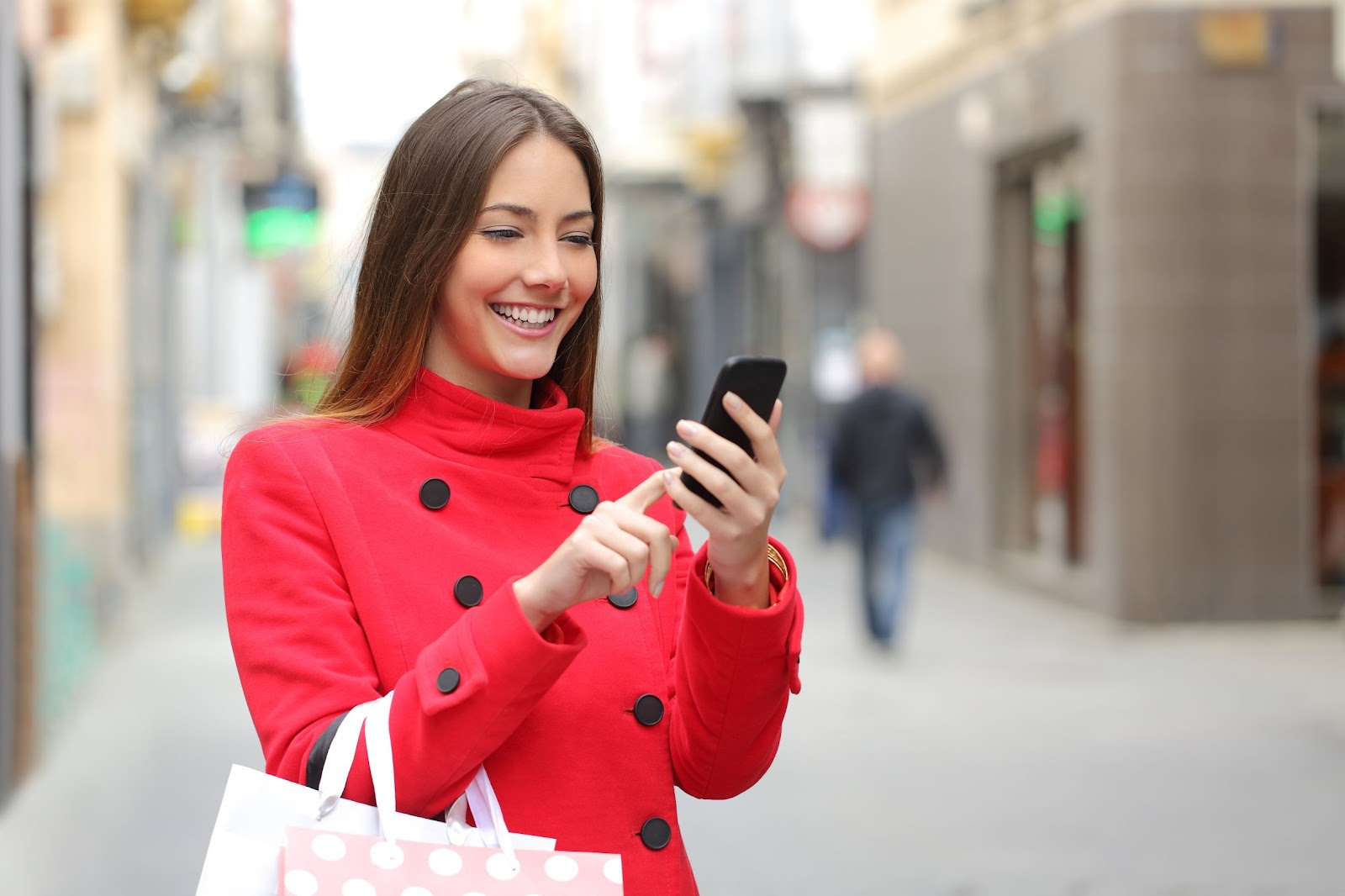 happy woman engaging with sms marketing e-commerce on her mobile phone