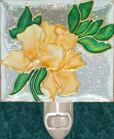 yellow tea rose on clear textured glass
